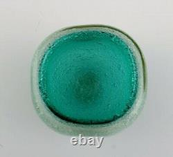 Murano bowl in turquoise mouth blown art glass with inlaid bubbles. 1960's
